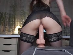 Girl in stockings rides a huge dildo for her horny fans